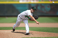Dayton Dragons relief pitcher Aaron Fossas (18) follows through on his delivery against the West Michigan Whitecaps at Fifth Third Field on May 29, 2017 in Dayton, Ohio.  The Dragons defeated the Whitecaps 4-2.  (Brian Westerholt/Four Seam Images)