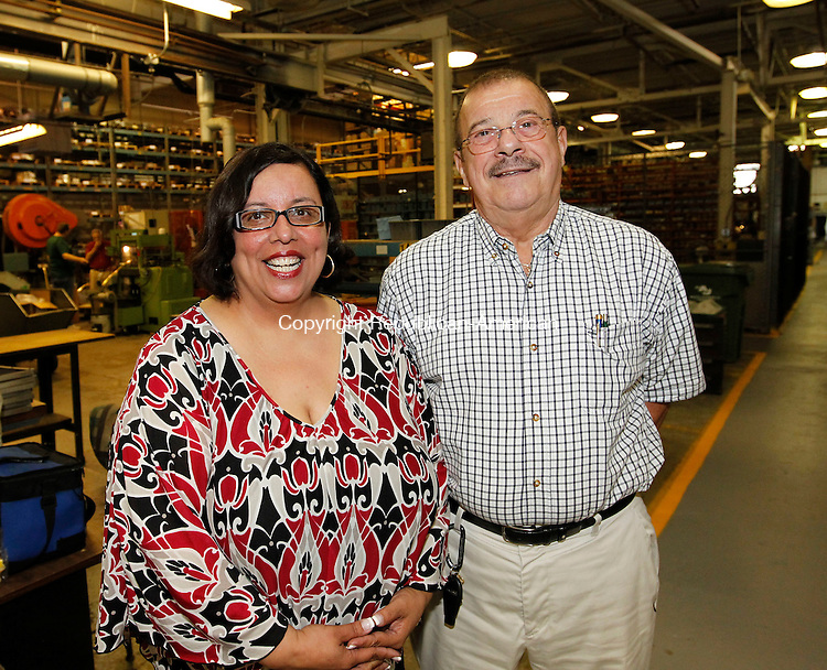 Cheshire, CT-24 August 2012-082412CM07-  Social Moments. Waterbury Button's open house to celebrate its 200th Anniversary.  From L-R Nivea Manning, Manufacturing Supervisor and Sal Gerali, Vice President of OGS Technologies.   Christopher Massa Republican-American