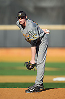 Missouri Tigers relief pitcher Peter Fairbanks (37) looks to his catcher for the sign against the Radford Highlanders at Wake Forest Baseball Park on February 21, 2014 in Winston-Salem, North Carolina.  The Tigers defeated the Highlanders 15-3.  (Brian Westerholt/Four Seam Images)