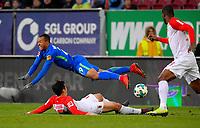 25.11.2017,  Football 1.Liga 2017/2018, 13. match day, FC Augsburg - VfL Wolfsburg, in WWK-Arena Augsburg, Marcel Tisserand (Wolfsburg) fliegt ueber Ja-Cheol Koo (Augsburg). *** Local Caption *** © pixathlon<br /> <br /> +++ NED + SUI out !!! +++<br /> Contact: +49-40-22 63 02 60 , info@pixathlon.de
