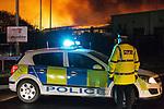 © Joel Goodman - 07973 332324 .21/12/2011 . Lancashire , UK . Fire fighters tackle a large fire spread across several buildings on an industrial estate at Enterprise Court on Spurrier Street, in Leyland . Photo credit: Joel Goodman
