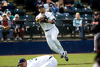June 8, 2008: Tacoma Rainiers third baseman Matt Tuiasosopo barehands a slow roller and throws on the run during a Pacific Coast League game against the Fresno Grizzlies at Cheney Stadium in Tacoma, Washington.
