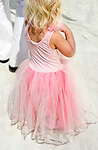 A young girls dressed up as a ballerina.