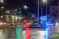 Pictured: Police by the flooded A4242 which runs through the city centre in Carmarthen, Wales, UK. Saturday 13 October 2018<br /> Re: River Towy has burst its banks and adjacent properties have flooded, caused by storm Callum, in Carmarthen, west Wales, UK.