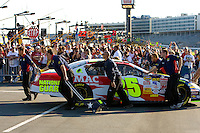 Fans stand on pit road during the Bank of America 500 NASCAR race at Lowes's Motor Speedway in Concord, NC.