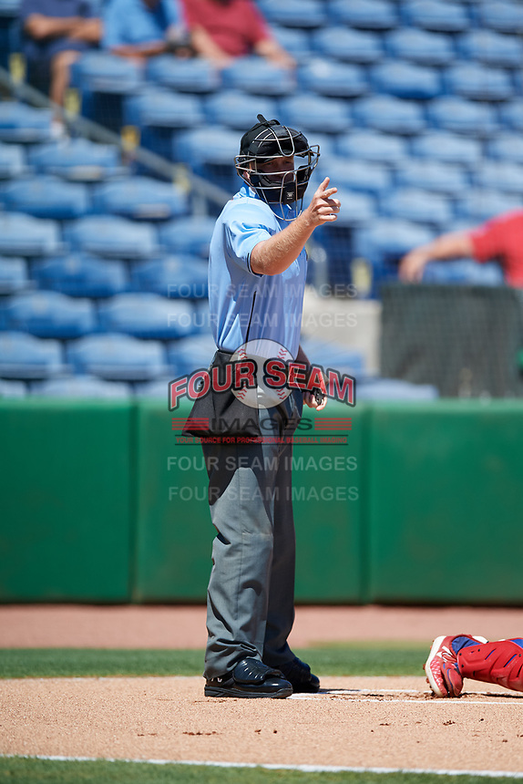 Home plate umpire Mike Carroll calls a strike during a game between the Jupiter Hammerheads and the Clearwater Threshers on April 11, 2018 at Spectrum Field in Clearwater, Florida.  Jupiter defeated Clearwater 6-4.  (Mike Janes/Four Seam Images)
