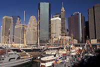AJ4343, Manhattan, New York City, South Street Seaport, N.Y.C., New York, NYC, navy, Navy cadet fleet docked at South Street Seaport in Manhattan on the East River in New York City in the state of New York. Manhattan skyline in the background.