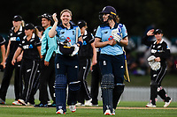 23rd February 2021, Christchurch, New Zealand;  Heather Knight and Nat Sciver of England celebrate winning the 1st ODI Cricket match, New Zealand versus England, Hagley Oval, Christchurch, New Zealand