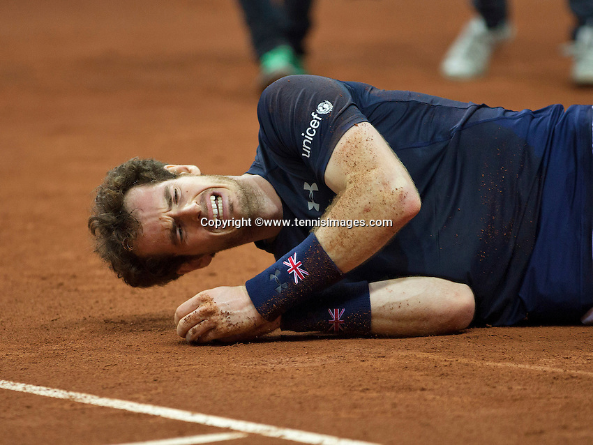 Gent, Belgium, November 29, 2015, Davis Cup Final, Belgium-Great Britain, day three, Andy Murray (GBR) goes down on the clay after defeating David Goffin and scoring the winning point for Great Britain 3-1, Great Britain wins the Davis Cup 2015.<br /> Photo: Tennisimages/Henk Koster