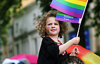 A young girl with National Trust flags in this year's Pride Parade in the centre of Cardiff, Wales, UK. Sayurday 26 August 2017