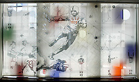 A printed mural hangs in front of a stained glass window in the recruiting center at Ohio Stadium Thursday, May 20, 2004 in Columbus, Ohio.