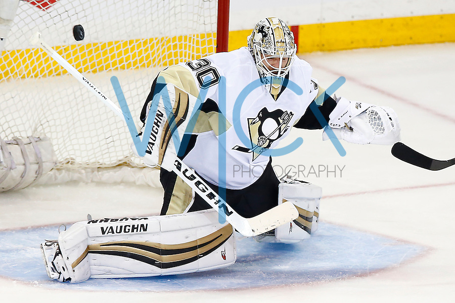 Matt Murray #30 of the Pittsburgh Penguins makes a save in the second period against the New York Rangers during game four of the first round of the Stanley Cup Playoffs at Madison Square Garden in New York City on April 21, 2016. (Photo by Jared Wickerham / DKPS)