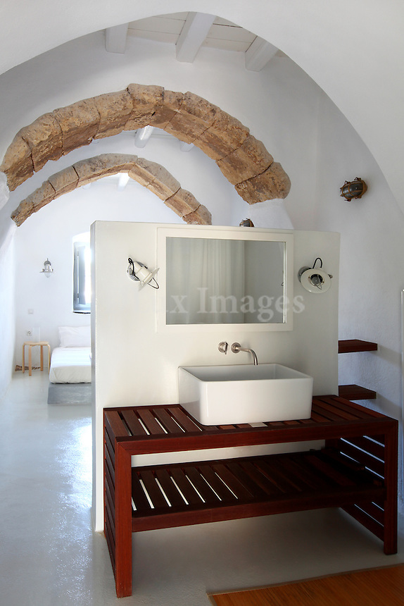 traditional bedroom with open plan bathroom