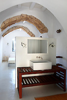 traditional bedroom with open plan bathroom