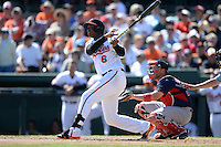 Baltimore Orioles second baseman Jonathan Schoop (6) at bat in front of catcher Ryan Lavarnway (20) during a spring training game against the Boston Red Sox on March 8, 2014 at Ed Smith Stadium in Sarasota, Florida.  Baltimore defeated Boston 7-3.  (Mike Janes/Four Seam Images)