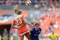Houston, TX - Saturday May 27, 2017: Cami Privett (23) of the Houston Dash wins a header over Katie Johnson during a regular season National Women's Soccer League (NWSL) match between the Houston Dash and the Seattle Reign FC at BBVA Compass Stadium.
