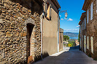 Gassin ancient typical village Mediterranean narrow street and stone houses, with a view on the gulf of Saint-Tropez, France Azure Coast France