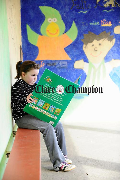 Niamh Mc Namara reading during sos at Dangan NS. Photograph by John Kelly.