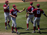 LOS ANGELES, CA - April 10, 2011: The Stanford baseball infield welcomes Danny Sandbrink to the mound for relief during Stanford's game against USC at Dedeaux Field in Los Angeles. Stanford lost 6-2.