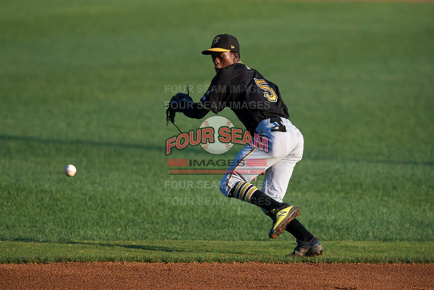 Bristol Pirates shortstop Victor Ngoepe (5) fields a ground ball during a game against the Bluefield Blue Jays on July 26, 2018 at Bowen Field in Bluefield, Virginia.  Bristol defeated Bluefield 7-6.  (Mike Janes/Four Seam Images)