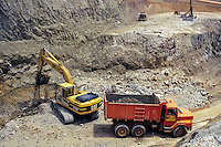 Ivory Coast (Cote d'Ivoire).  Excavating for Gold  in Open pit mine, Afema Mine.