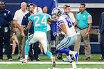 Miami Dolphins defensive back Isa Abdul-Quddus (24) and Dallas Cowboys tight end Geoff Swaim (87) in action during the pre-season game between the Miami Dolphins and the Dallas Cowboys at the AT & T stadium in Arlington, Texas.