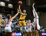 SIOUX FALLS, SD - MARCH 8: Reneya Hopkins #0 of the North Dakota State Bison shoots over Maddie Krull #42 of the South Dakota Coyotes during the Summit League Basketball Tournament at the Sanford Pentagon in Sioux Falls, SD. (Photo by Dave Eggen/Inertia)