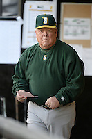 Siena Saints head coach Tony Rossi (40) in the dugout before the season opening game against the Central Florida Knights at Jay Bergman Field on February 14, 2014 in Orlando, Florida.  UCF defeated Siena 8-1.  (Mike Janes/Four Seam Images)