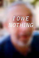 """Anonymous portrait taken in Cambridge, Massachusetts, USA,  paired with text answering the question: How much do you owe?  The project was produced as a look at personal debt for Longshot Magazine #2.  ..The person's response here reads: """"I owe nothing"""""""