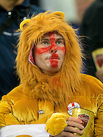An England fan dressed as a lion looks dejected