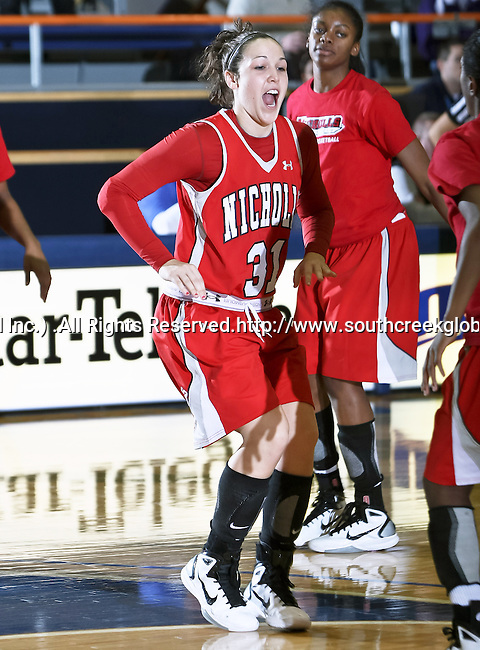 Nicholls State University Colonels forward Cassie Hearon (31) comes out onto the floor as she gets introduced before the game between the UTA Mavericks and the  Nicholls State University Colonels  held at the University of Texas in Arlington's Texas Hall in Arlington, Texas. UTA defeats Nicholls 69 to 62