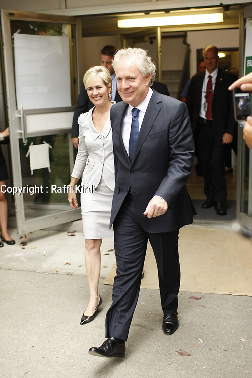 September 4, 2012 - Sherbrooke (Qc) CANADA - Quebec Premier and Liberal leader Jean Charest  leave with his wife after casting his vote in his riding.<br /> <br /> later that day he lost the Provincial election to Parti Quebecois (PQ) Leader Pauline Marois<br /> <br /> Photo (c) 2012 by Raffi Kirdi
