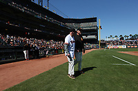 SAN FRANCISCO, CA - AUGUST 11:  Former San Francisco Giants manager Roger Craig walks onto the field with current manager Bruce Bochy during a ceremony honoring the 1989 Giants during a 30 year team reunion before the game between the Philadelphia Phillies and San Francisco Giants at Oracle Park on Sunday, August 11, 2019 in San Francisco, California. (Photo by Brad Mangin)