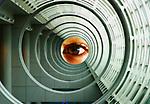 Chloe's eye seen through an architectural formation.