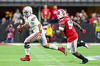 Indianapolis, IN - December 7, 2019: Ohio State Buckeyes quarterback Justin Fields (1) scrambles during the Big Ten championship game Wisconsin and Ohio St. at Lucas Oil Stadium in Indianapolis, IN.   (Photo by Elliott Brown/Media Images International)