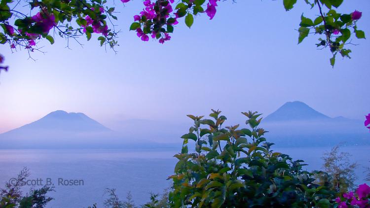 View of Volcanoes San Pedro, Atitlan, and Toliman at sunrise on Lake Atitlan, Guatemala