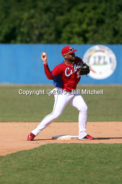 Pavel Quesada works out at the Dominican Republic air force base in front of 100+ Major League Baseball scouts prior to being declared eligible to sign since defecting from his native Cuba in Santo Domingo, Dominican Republic on February 11, 2015 (Bill Mitchell)