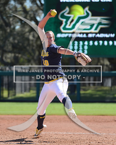 Michigan Wolverines Softball pitcher Sara Driesenga (10) delivers a pitch during a game against the Bethune-Cookman on February 9, 2014 at the USF Softball Stadium in Tampa, Florida.  Michigan defeated Bethune-Cookman 12-1.  (Copyright Mike Janes Photography)