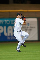 Scottsdale Scorpions Tim Tebow (15), of the New York Mets organization, throws the ball in during a game against the Mesa Solar Sox on October 17, 2016 at Scottsdale Stadium in Scottsdale, Arizona.  Mesa defeated Scottsdale 12-2.  (Mike Janes/Four Seam Images)
