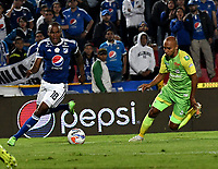 BOGOTA - COLOMBIA - 25 – 03 - 2018: Jair Palacios (Izq.) jugador de Millonarios disputa el balón con Leonardo Escorcia (Der.) jugador de Jaguares F. C., durante partido de la fecha 10 entre Millonarios y Jaguares F. C., por la Liga Aguila I 2018, jugado en el estadio Nemesio Camacho El Campin de la ciudad de Bogota. / Jair Palacios (L) player of Millonarios vies for the ball with Leonardo Escorcia (R) player of Jaguares F. C., during a match of the 10th date between Millonarios and Jaguares F. C., for the Liga Aguila I 2018 played at the Nemesio Camacho El Campin Stadium in Bogota city, Photo: VizzorImage / Luis Ramirez / Staff.