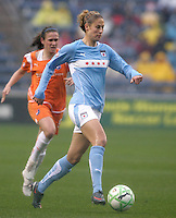 Chicago Red Stars defender Marian Dalmy (2) dribbles toward the Sky Blue FC goal while Sky Blue FC forward Heather O'Reilly (9) pursues.  The Chicago Red Stars tied Sky Blue FC 0-0 at Toyota Park in Bridgeview, IL on April 19, 2009.