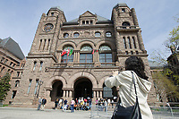 Toronto (ON) CANADA,  April , 2008-.A group of tourist take pictures of The Ontario Legislature in Queens Park...urban park in the Downtown area of Toronto. Opened in 1860 by Edward, Prince of Wales, it was named in honour of Queen Victoria. The park is the site of the Ontario Legislature, which houses the Legislative Assembly of Ontario, and so the phrase Queen's Park is also frequently used to refer to the Government of Ontario....