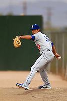 Pablo Gonzalez #30 of the AZL Dodgers throws in the bullpen during a game against the AZL Athletics at Phoenix Municipal Stadium on July 10, 2013 in Phoenix, Arizona. AZL Athletics defeated the AZL Dodgers, 7-1. (Larry Goren/Four Seam Images)