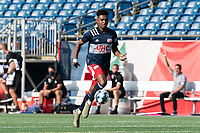 FOXBOROUGH, MA - JULY 25: USL League One (United Soccer League) match. Orlando Sinclair #99 of New England Revolution II receives pass, offsides, during a game between Union Omaha and New England Revolution II at Gillette Stadium on July 25, 2020 in Foxborough, Massachusetts.