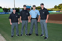 (L-R) Umpires John Budka, Dillon Wilson, Zach Neff, and Mark Bass prepare to work Game Two of the South Atlantic League Northern Division playoffs at Kannapolis Intimidators Stadium on September 8, 2017 in Kannapolis, North Carolina.  The Intimidators defeated the Grasshoppers to sweep the South Atlantic League Northern Division playoffs in two games.  (Brian Westerholt/Four Seam Images)