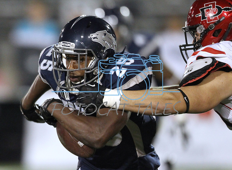Nevada's Stefphon Jefferson (25) tries to break free from San Diego State's  Derek Largent (50) during the first half of an NCAA college football game in Reno, Nev., on Saturday, Oct. 20, 2012. (AP Photo/Cathleen Allison)