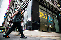 NEW YORK, NY - AUGUST 8: A man passes by a retail store closed in Times Square on August 8, 2020 in New York City. With more than four months NYC has closed some of their doors to combat the coronavirus, putting its vital tourism industry paralyzed with a moribund economy, where business and leaders are trying to revive an industry that brought in $45 billion annually and supported more than 300,000 jobs. (Photo by Eduardo MunozAlvarez/VIEWpress)