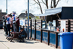 Lowestoft Town 2 Barrow 3, 25/04/2015. Crown Meadow, Conference North. Barrow make the six-hour trip to Suffolk needing a win to secure the title. With 1402 fans packed into Crown Meadow some take to standing on the park bench beside the tea hut to grab a view of the action. Photo by Simon Gill.