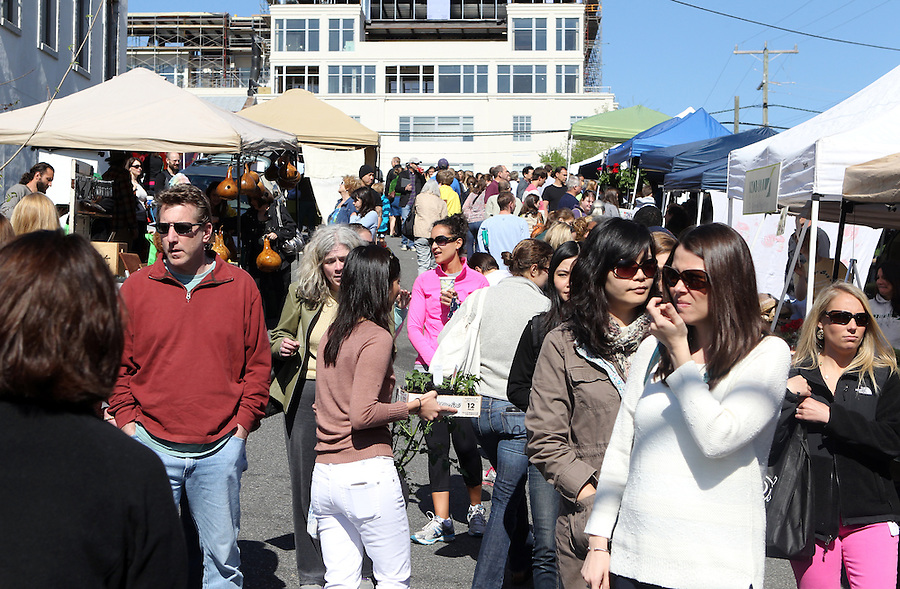 Large crowds attend the City of Charlottesville farmers market located off Water Street in Charlottesville, VA. Photo/Andrew Shurtleff