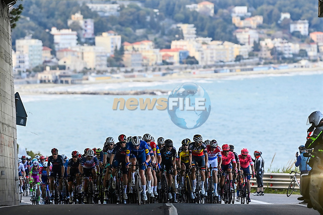 The peloton climb Capo Berta during the 112th edition of Milan-San Remo 2021, running 299km from Milan to San Remo, Italy. 20th March 2021. <br /> Photo: LaPresse/Fabio Ferrari | Cyclefile<br /> <br /> All photos usage must carry mandatory copyright credit (© Cyclefile | LaPresse/Fabio Ferrari)